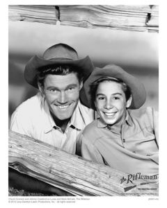 Publicity still of Connors and Crawford (log fence)