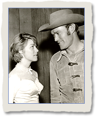 Luann Anders as Lisabeth Bishop and Chuck Connors