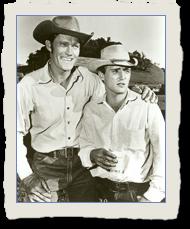 Dennis Hopper as Johnny Clover posing with Chuck C