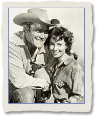 Gigi Perreau as Heller Chase and Chuck Connors as